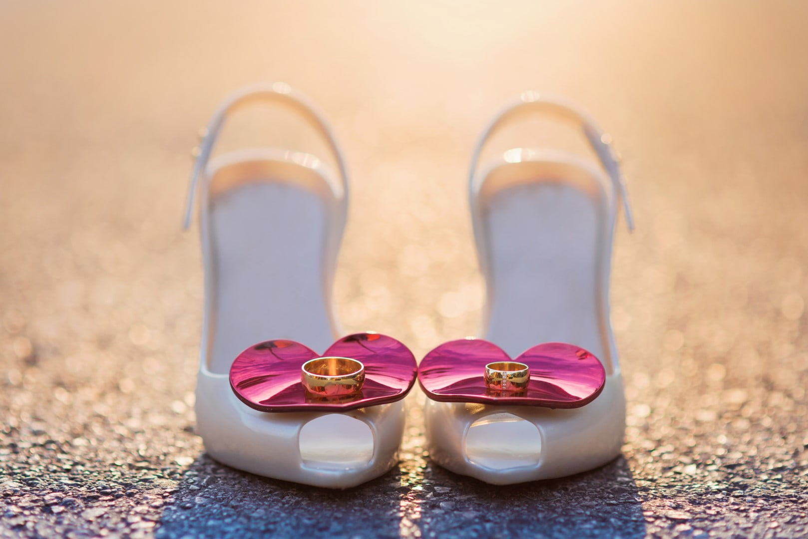 Wedding ring photo idea on the bride's shoes