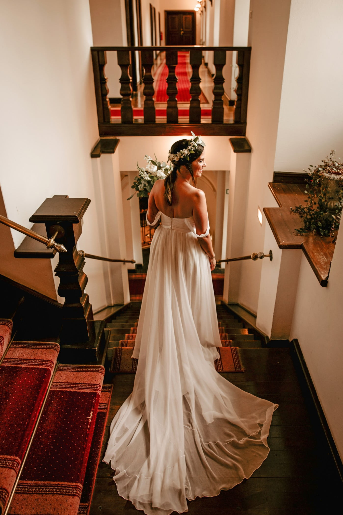 Traditional and bohemian fusion dress on bride with flower crown