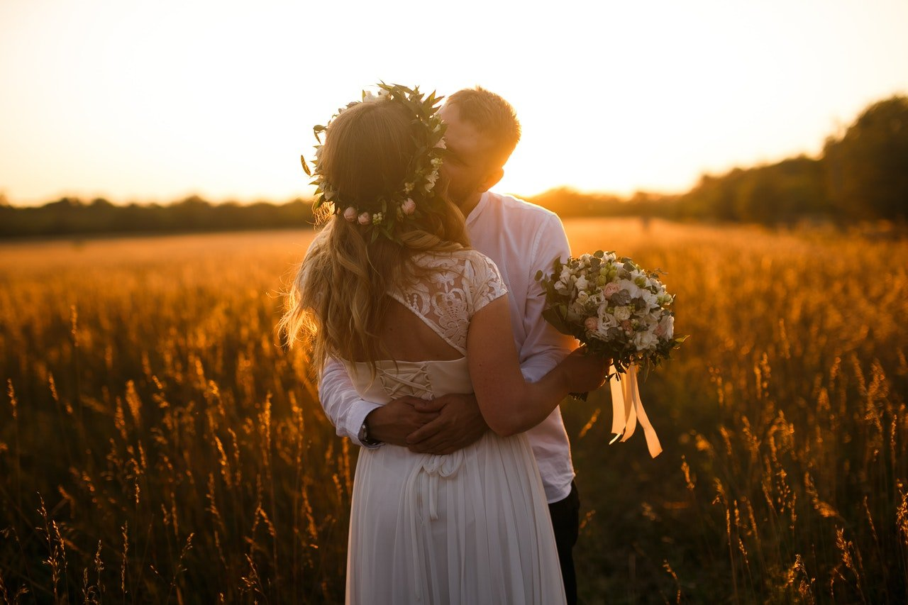 The flower crown, lace, and tied back come together for a gorgeous boho wedding dress look