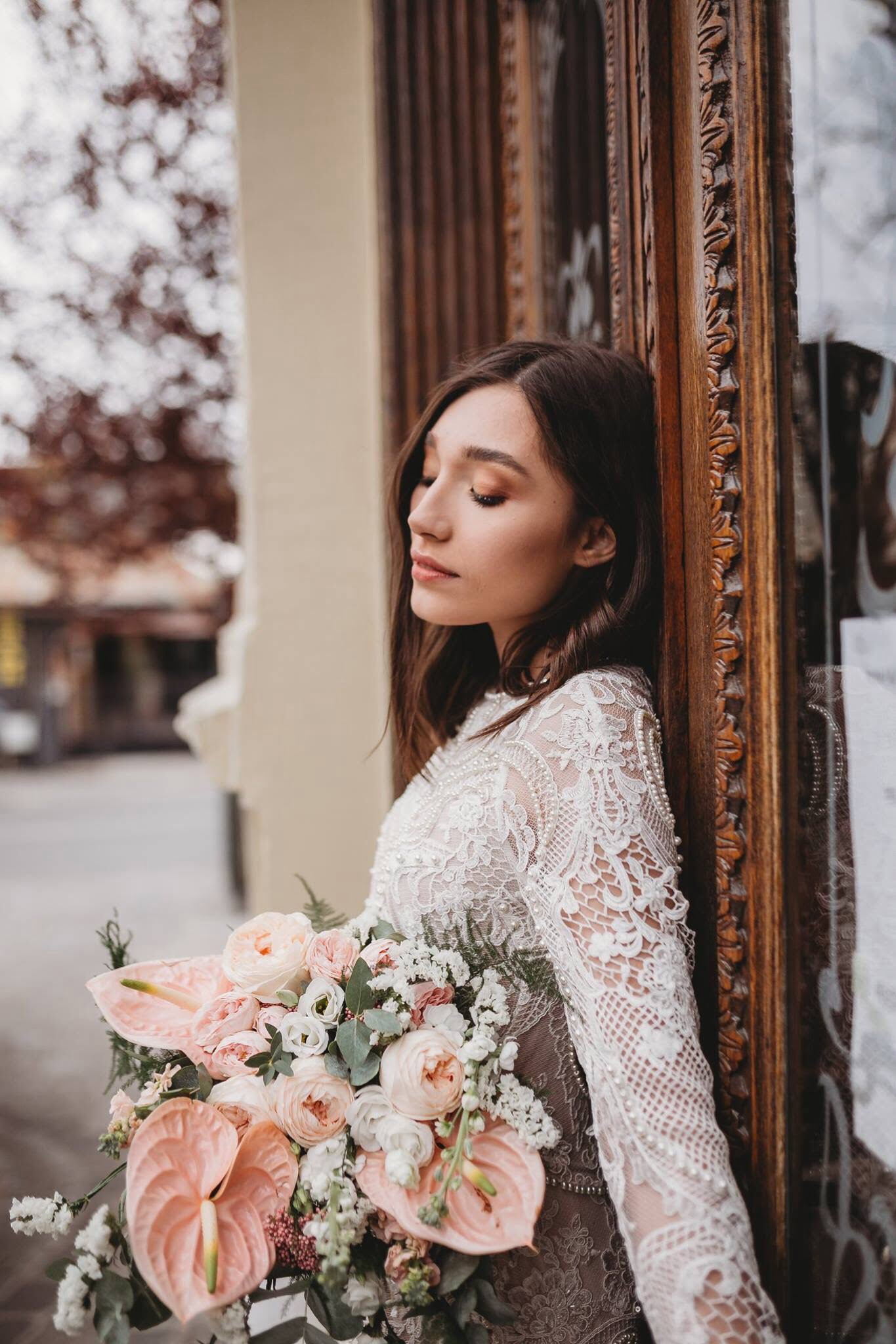 Long sleeves and fancy laces are part of this boho wedding dress