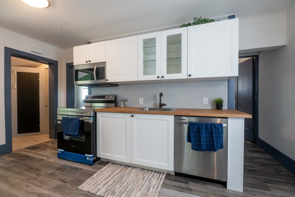 brand new renovated kitchen that's white with butcher block countertops