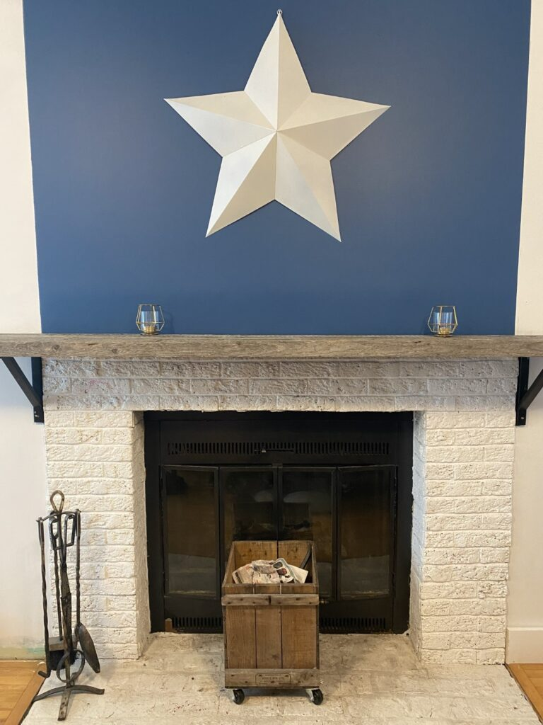 Updated fireplace with new paint and a mantle