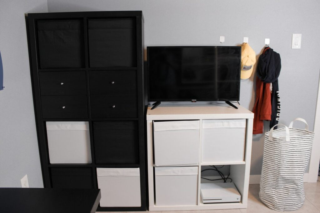 Storage solution for tween boys includes two ikea kallax shelves side by side
