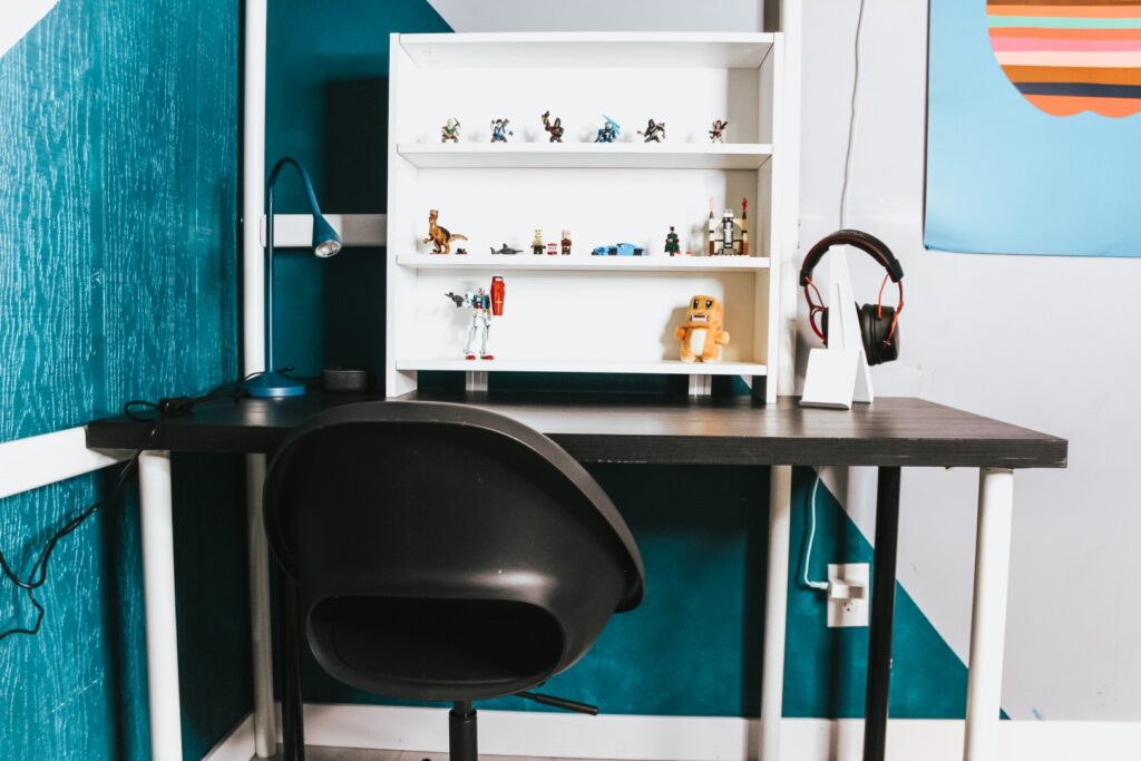 Desk with accessories on it like a shelf and lamp